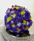 a bridal bouquet purple roses purple orchids accents of bling