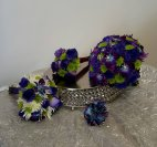 a bridal bouquet purple roses, blue purple orchids bling lime